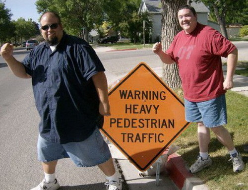 Heavy Pedestrian Traffic Fat Guys Sign