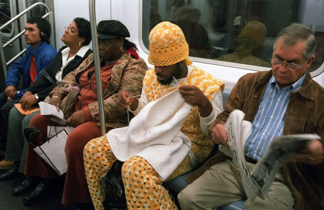 black guy knitting on the subway